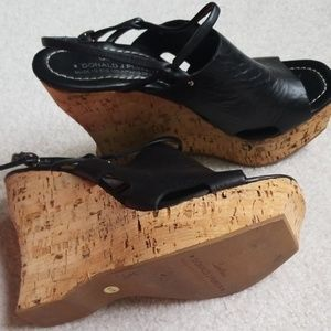 Black wedge couture sandals.